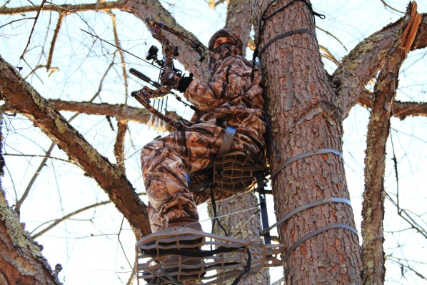 Hunter Sitting on a Tree Stand