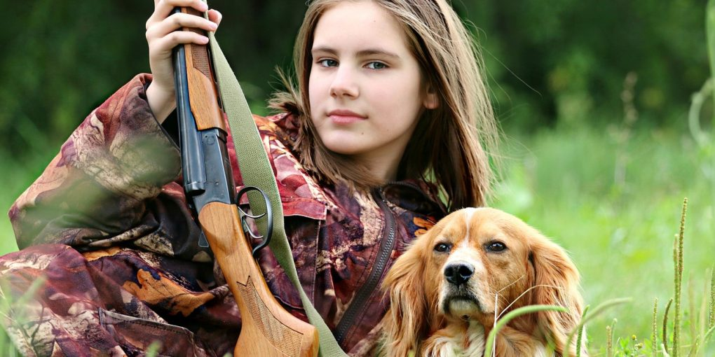 girl hunter with dog