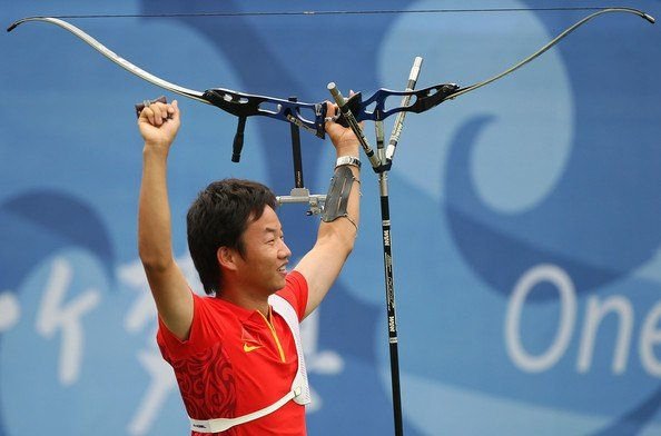 An Olympian using a recurve bow