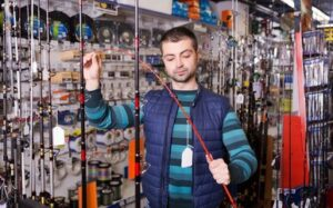fisherman choosing fishing rod - why hunting is good