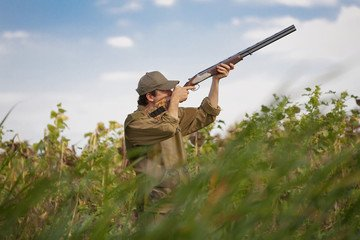 man holding Cricket 22 Rifle
