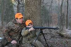 Two men practicing rifle
