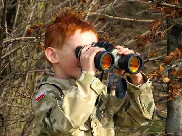 Boy holding binocular