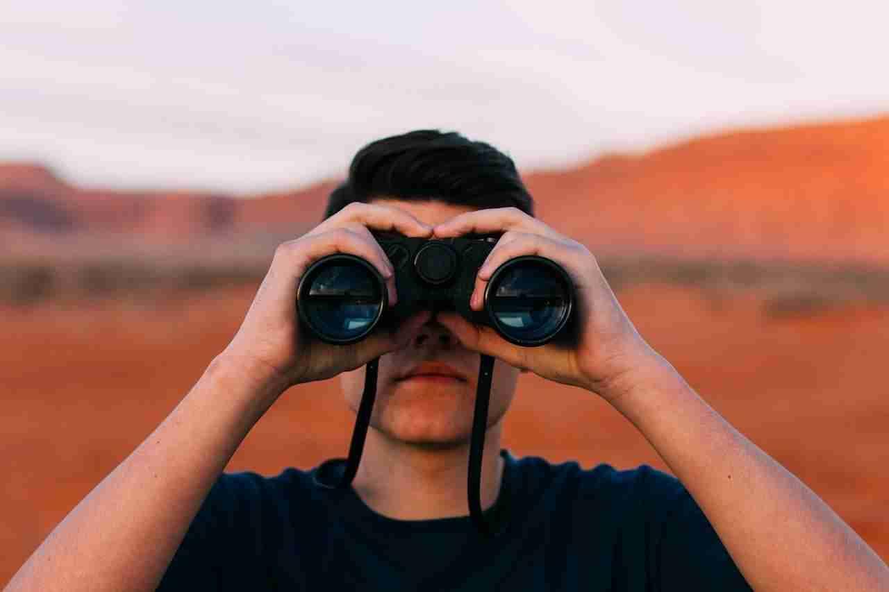 man using a binocular
